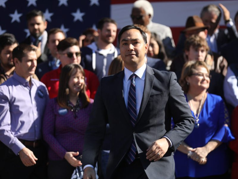 United States Representative Joaquin Castro approaches the stage to introduce his mother, Rosie Castro.