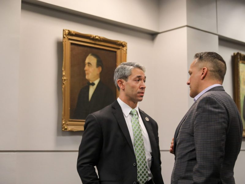 Mayor Ron Nirenberg (left) speaks briefly with Councilman Greg Brockhouse (D6) before a meeting to decide on a finalist for the City Manager position.