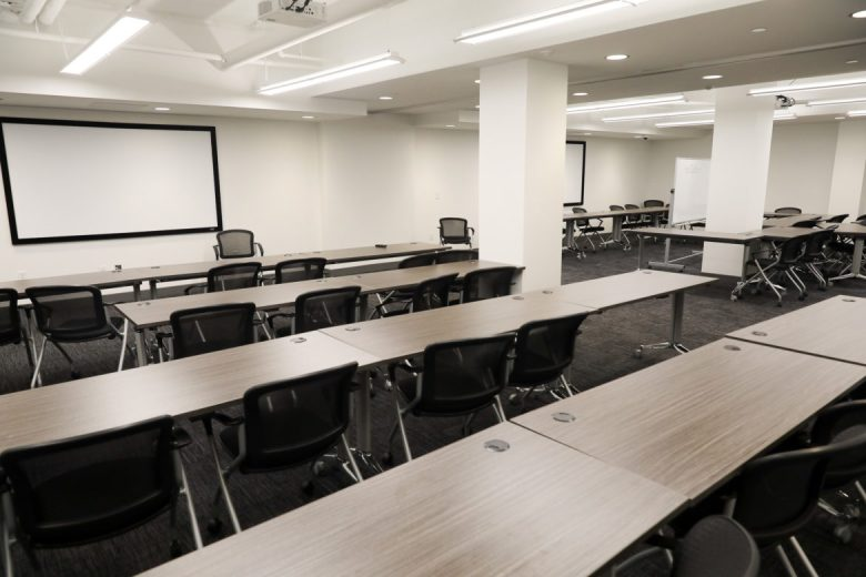 A large educational room can be divided by a partition for simultaneous teaching sessions in the Geekdom basement.