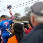A Harlem Globetrotter spins a ball on his index finger during the march.