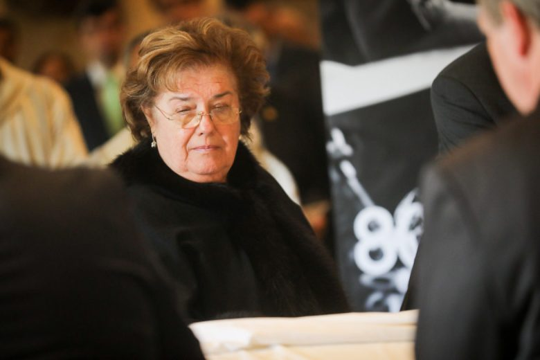 Irene Elizondo, widow of Paul Elizondo, looks over her husbands casket at San Fernando Cathedral.