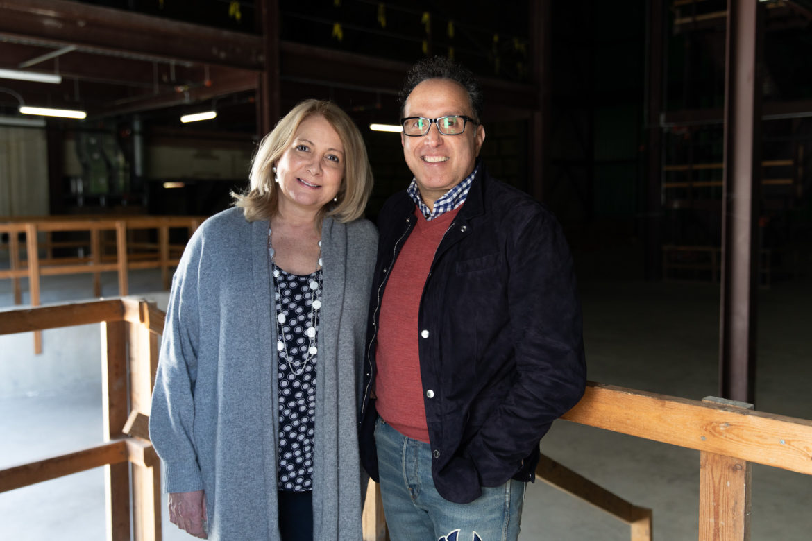 (from left) TPR President and CEO Joyce Slocum and Guillermo Nicolas stand for a photo inside the historic Alameda Theater, the future headquarters of TPR.