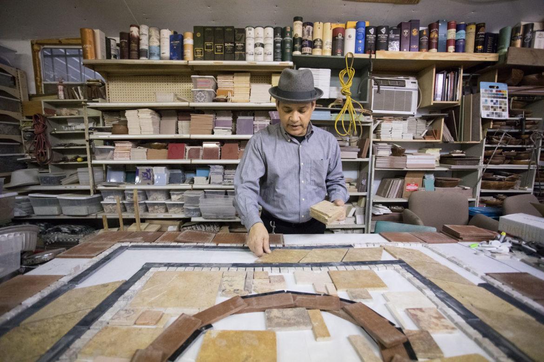 Artist Oscar Alvarado works in his studio space.