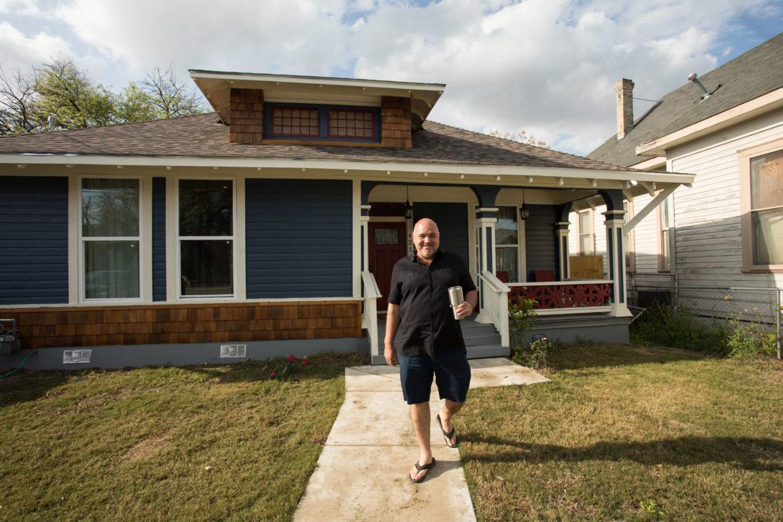 Abe Juarez walks to his truck through his front yard.