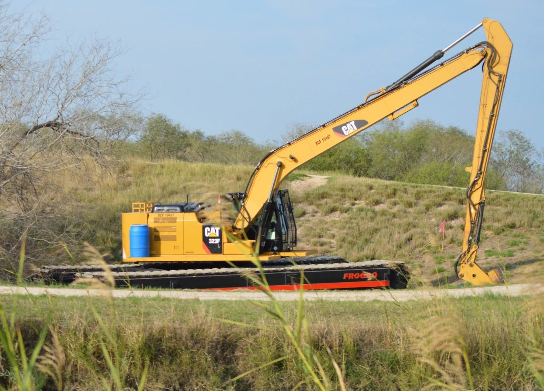 An excavator confirmed by U.S. Customs and Border Protection to be for border wall construction sits on La Parida Banco National Wildlife Refuge land.