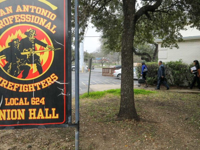 City employees leave the San Antonio Professional Firefighters Union Hall following day one of contract negotiations.