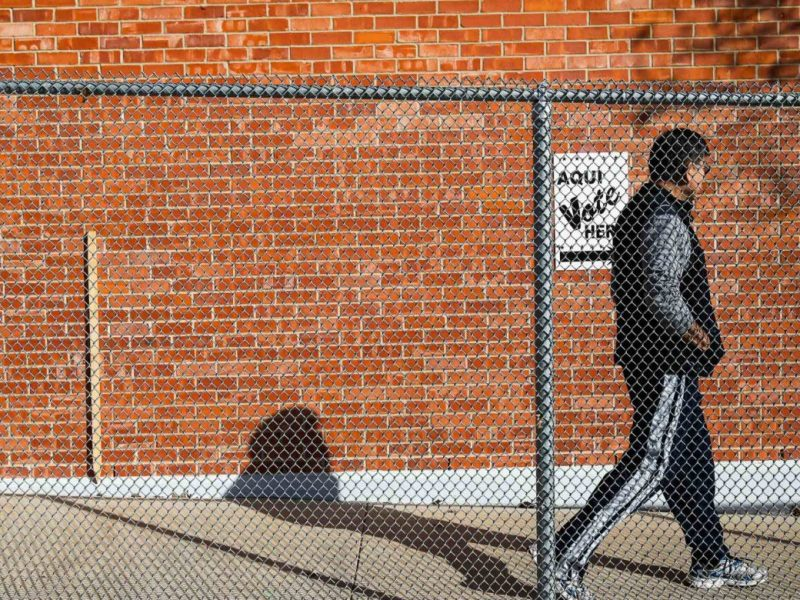 A voter walks to a polling site for the special election on election day at Lawrence Powell Elementary School.
