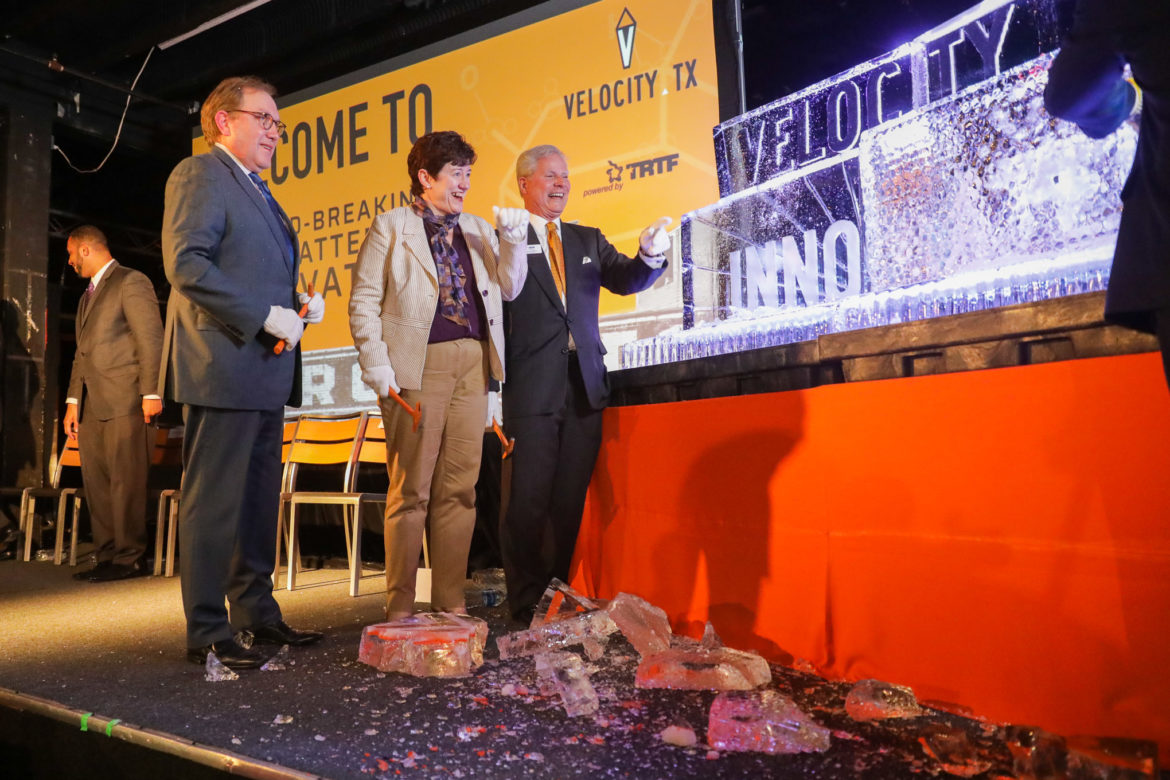 A large ice sculpture is crushed during the 'Break the Ice' ceremony hosted by Velocity, TX.