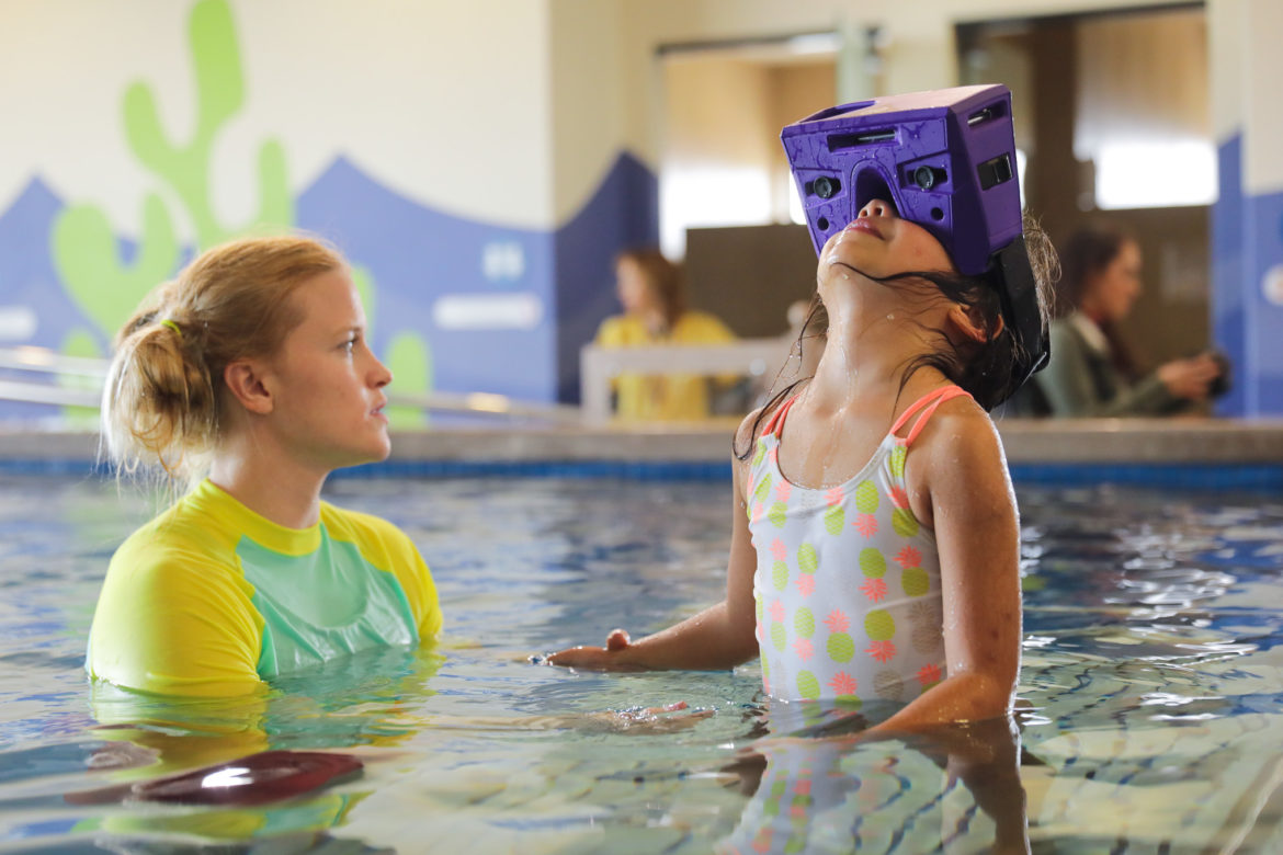 Olivia, 5, tests out the VR simulation during the therapy session.