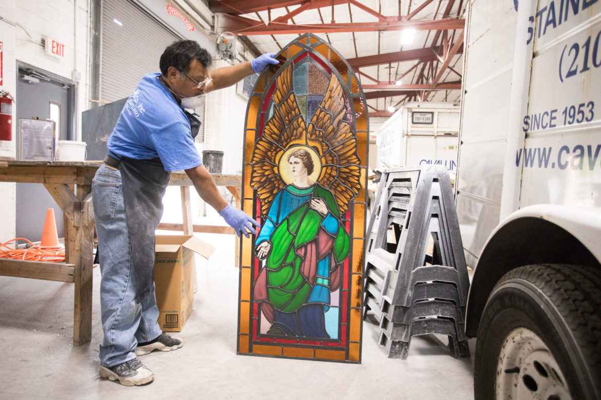 Francisco Romero, a 25-year employee, is working on the framing for a set of 19 stained glass windows Cavallini designed and created for St. Paul's Catholic Church in Smithville, Texas.