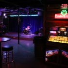 The stage and jukebox inside the Lonesome Rose.