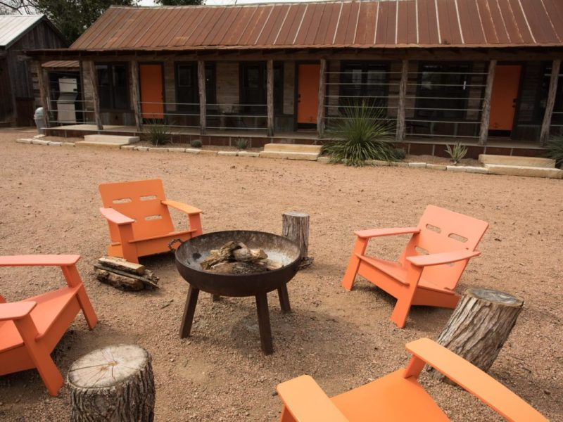 A communal sitting space around a fire at Camp Comfort.