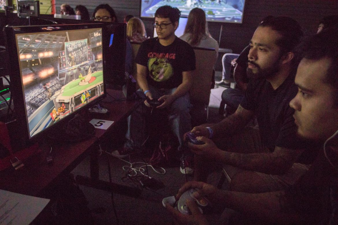 """(From right) Oscar """"Oasis"""" Robles and Nick """"Nik"""" Cruz compete against one another on Super Smash Bros."""