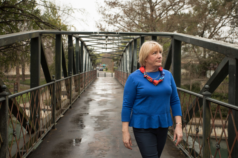 Shelley Galbraith walks along the Johnson Street Pedestrian Bridge in King William.