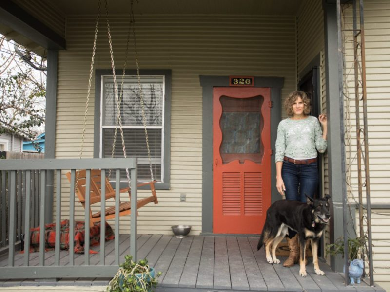 Linda Stone with her rescue shepherd Pelusa on her front porch.