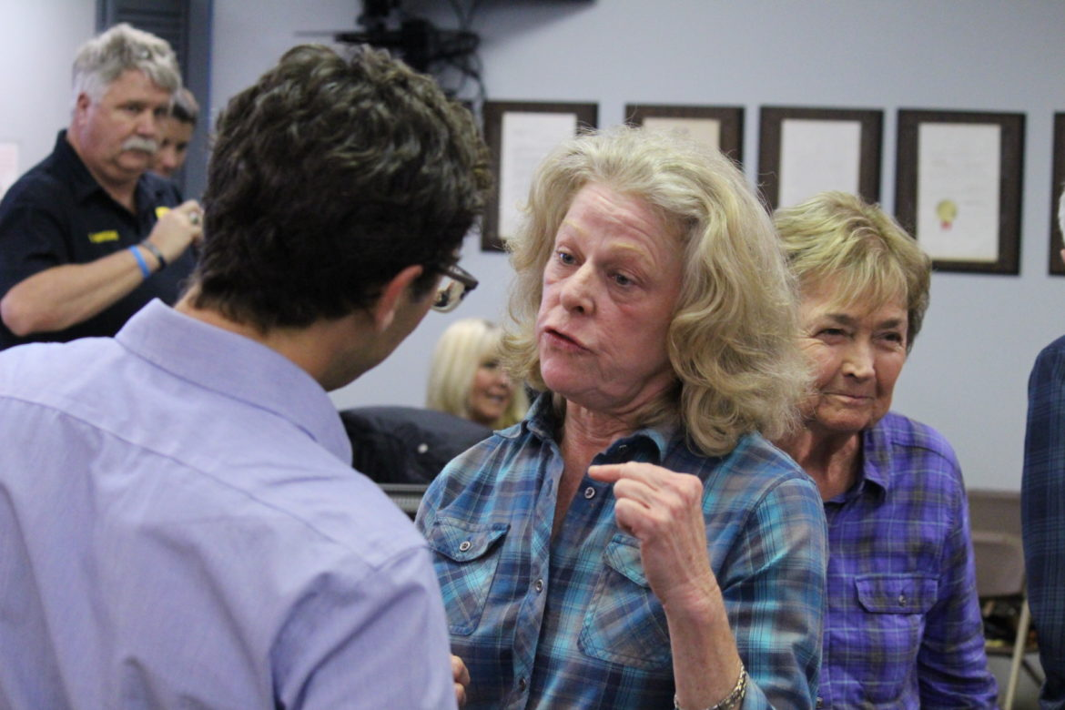 Port Aransas Conservancy member Cathy Fulton speaks with Port of Corpus Christi community planner Jeff Pollack at a February City Council meeting.