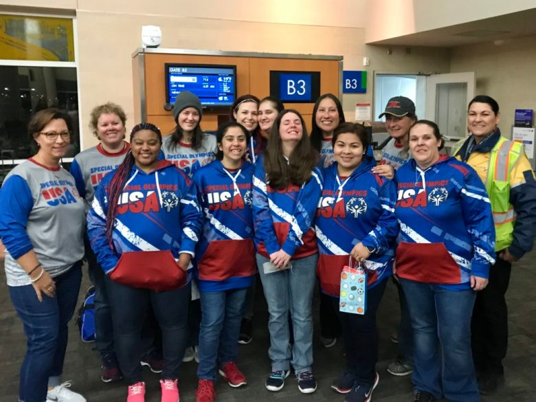 Special Olympics USA participants take a photo together at the airport before leaving for Abu Dhabi.