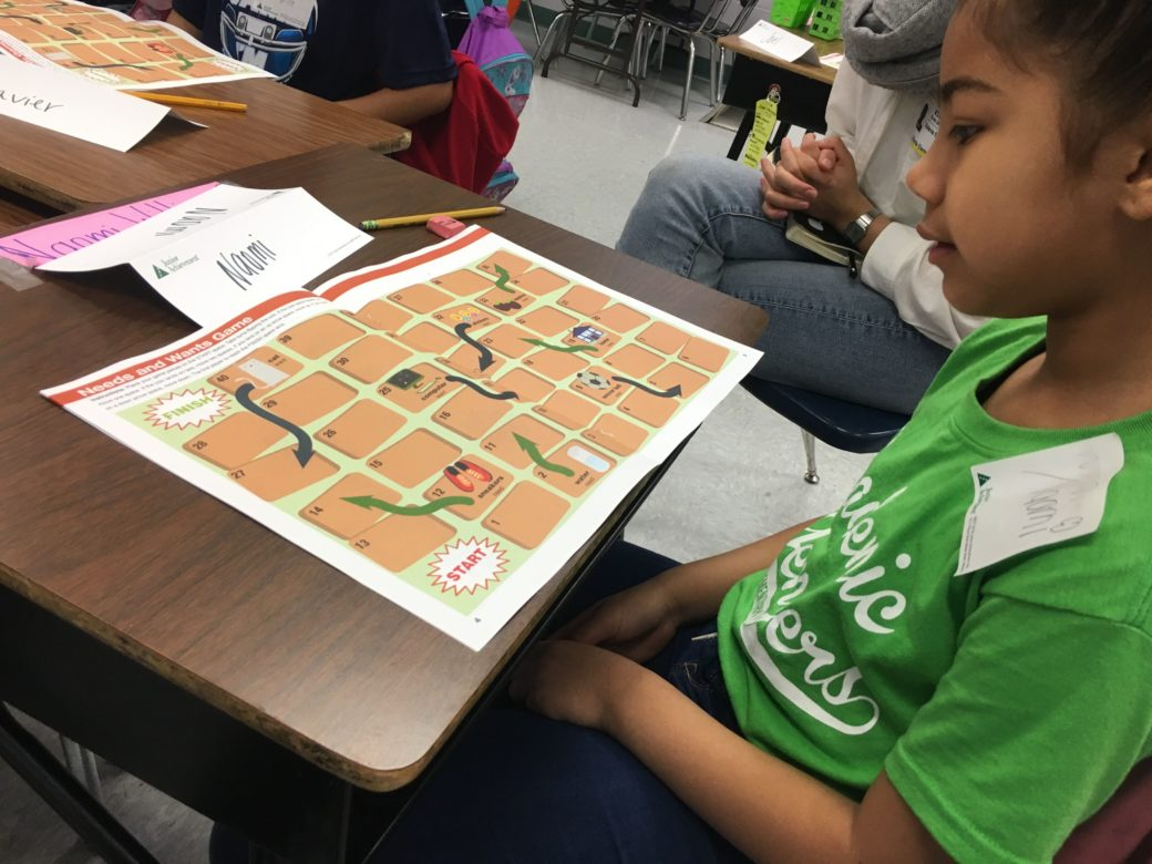 Naomi, a Gillette Elementary School student works on a Junior Achievement activity that helps students separate the wants from the needs.