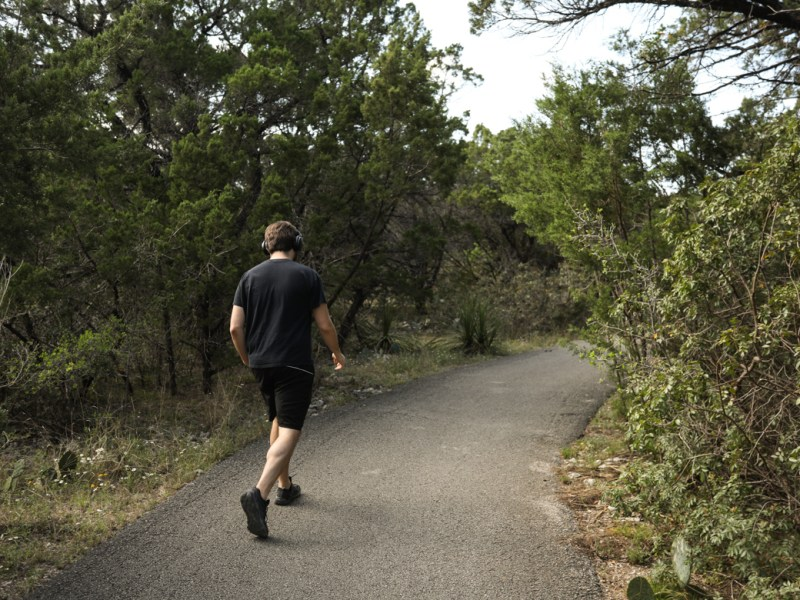 A walker makes his way through the extensive trail system at Dwight D. Eisenhower Park.