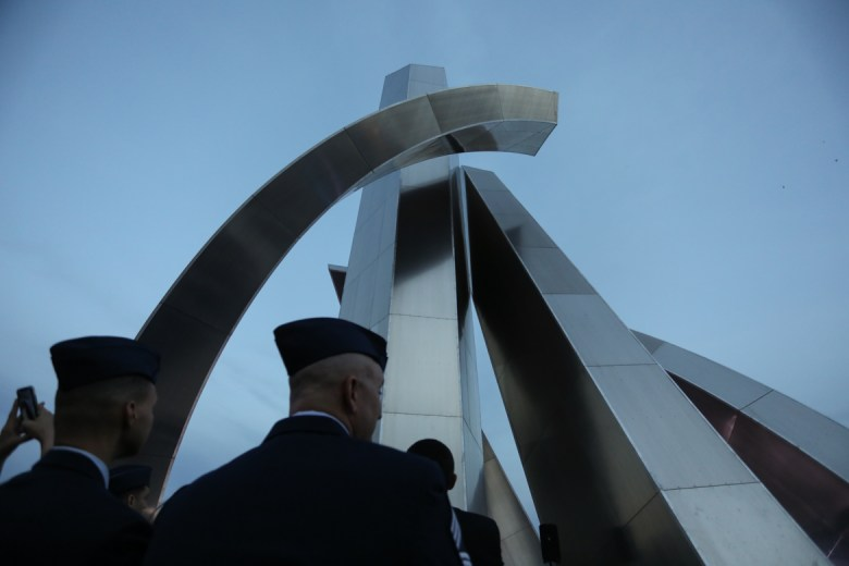 Military members attend the unveiling ceremony for the Tribute to Freedom monument.