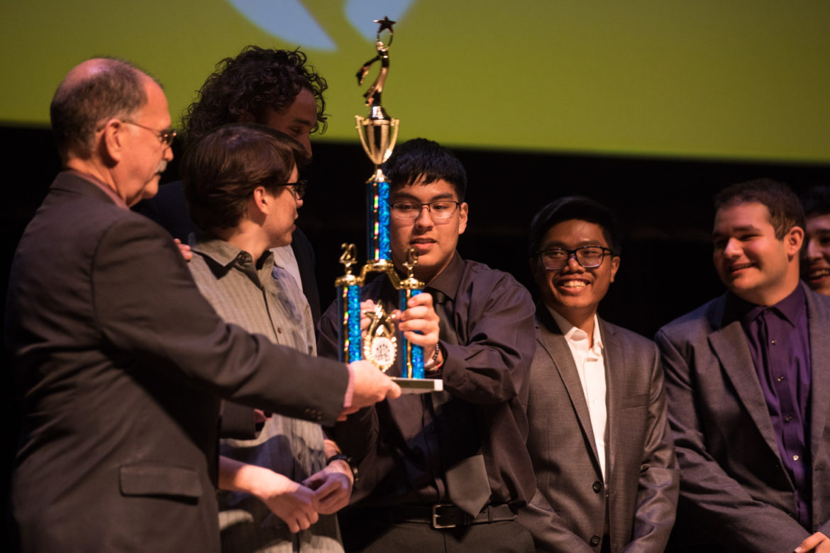 San Antonio Area Foundation Director of Grants and Programs Gavin Nichols (left) gives the Editing Award to East Central High School.