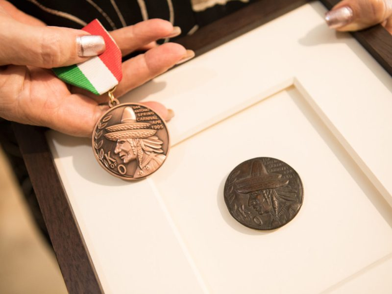 (From right) The original Fiesta medal of the Coppini Academy of Fine Arts next to the 2019 medal.