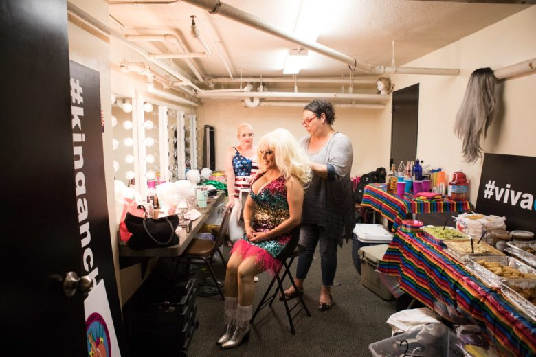 """""""Dolly Parton"""" gets the final touches on her hair and makeup before the performance."""