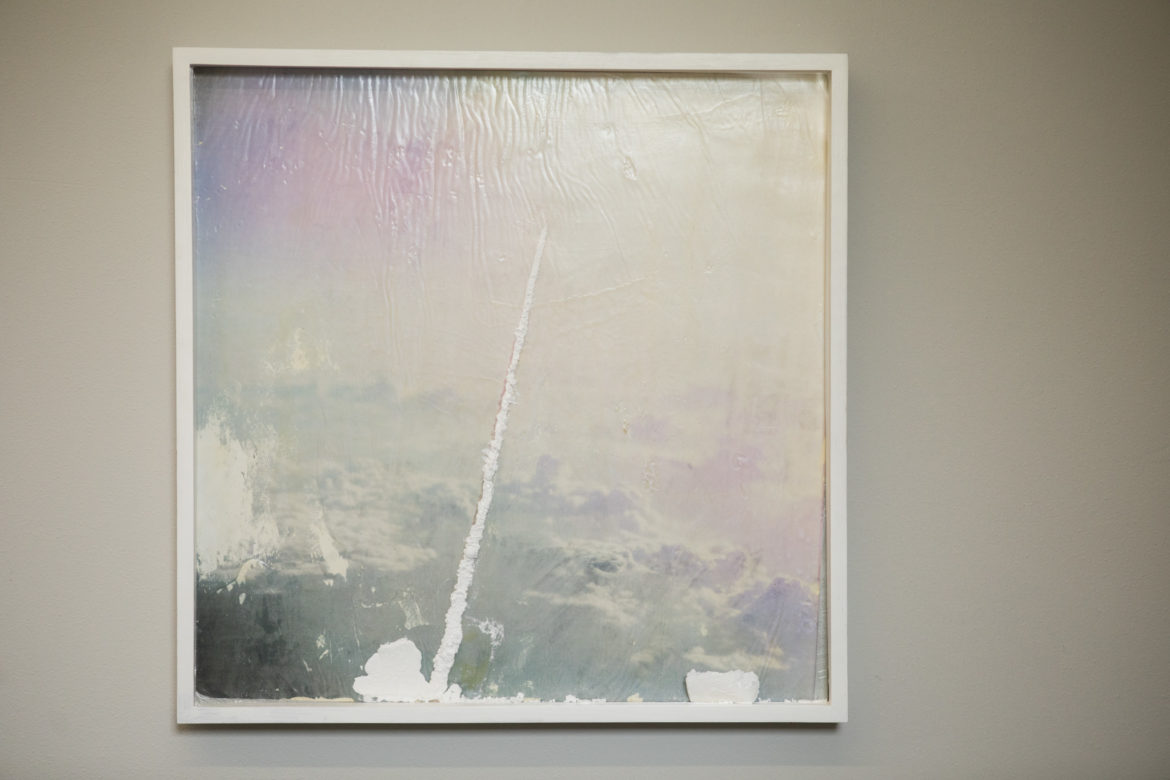 A piece by Jason Willome hangs in the Gonzales Gallery.