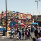 Hundreds of people walk through the carnival area at Oyster Bake.