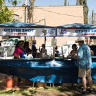 While oysters in a shell are not available until 5 p.m., oyster shots are sold to attendees.