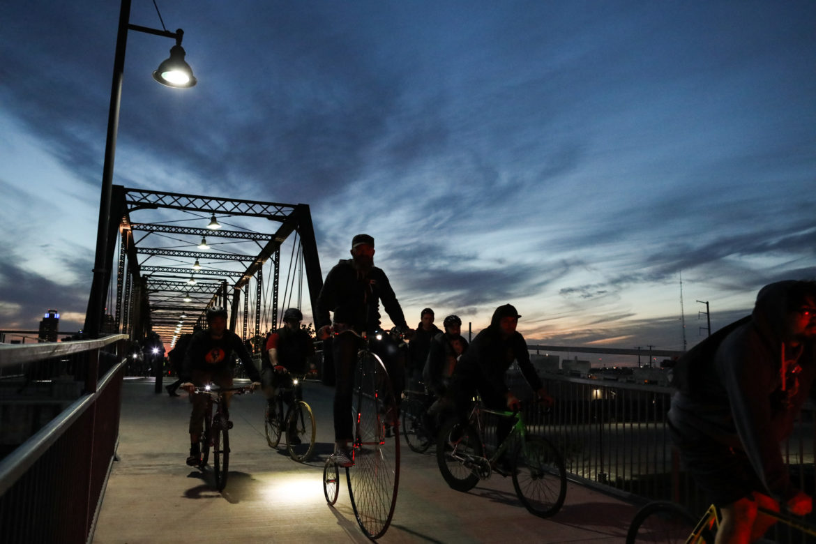 Hundreds of people ride their bicycles across Hays Street Bridge in memory of Tito Bradshaw.
