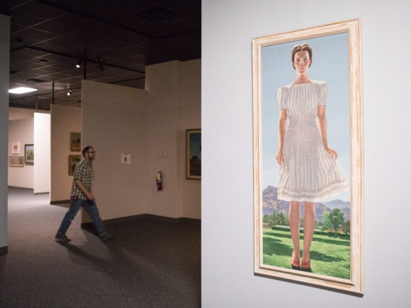 Richard Naylor, Exhibit Carpenter for the Witte Museum, walks behind Sarah in the Summertime by Tom Lea.