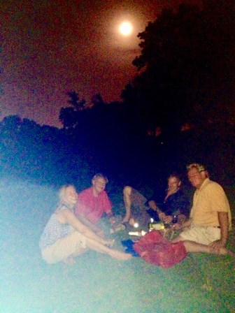 "(from left) Annalisa Peace, Jim Smith, Bill Sibley and Gene Elder ""Moonbathing"" in the Brackenridge Golf Course."