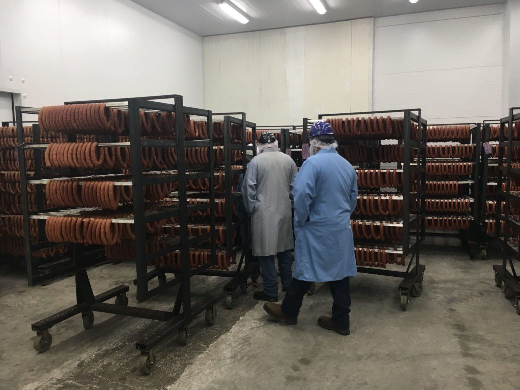 Kiolbassa sausage is lined on racks in the new facility.