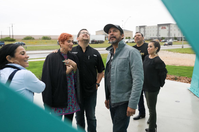 Local artist Cruz Ortiz looks at his work Sun Mountain honoring the late Frank Tejeda.