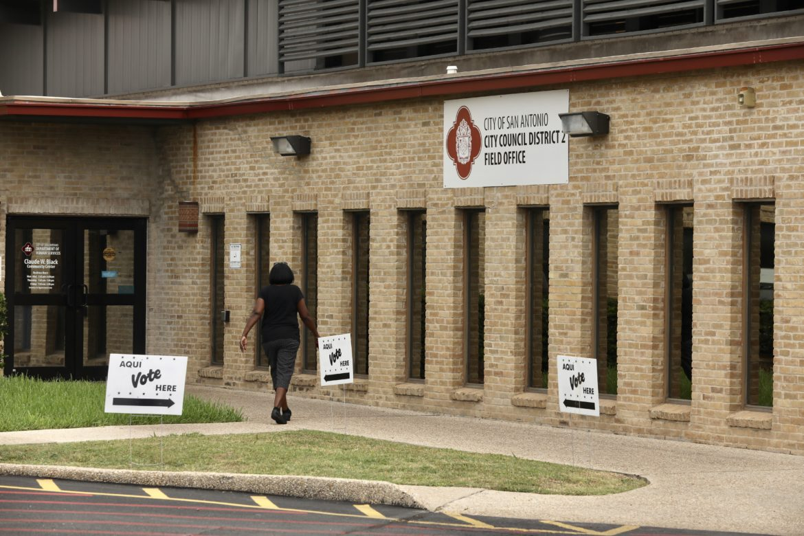 Voters arrive for early voting at the Claude Black Community Center in District 2.