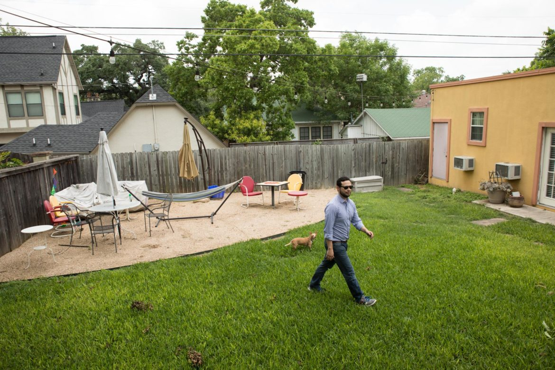 Andrew Casillas walks through the backyard with his dog Jackson.Andrew Casillas walks through the backyard with his dog Jackson.