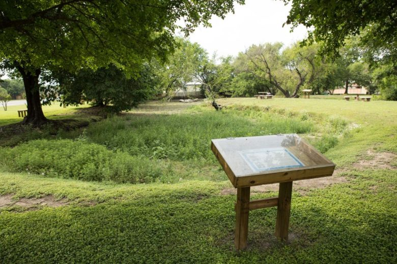 Information regarding the Eden Pond Preserve and its wildlife is displayed in a case next to the pond.