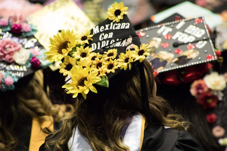 OLLU graduates decorate their hats with inspiring messages.