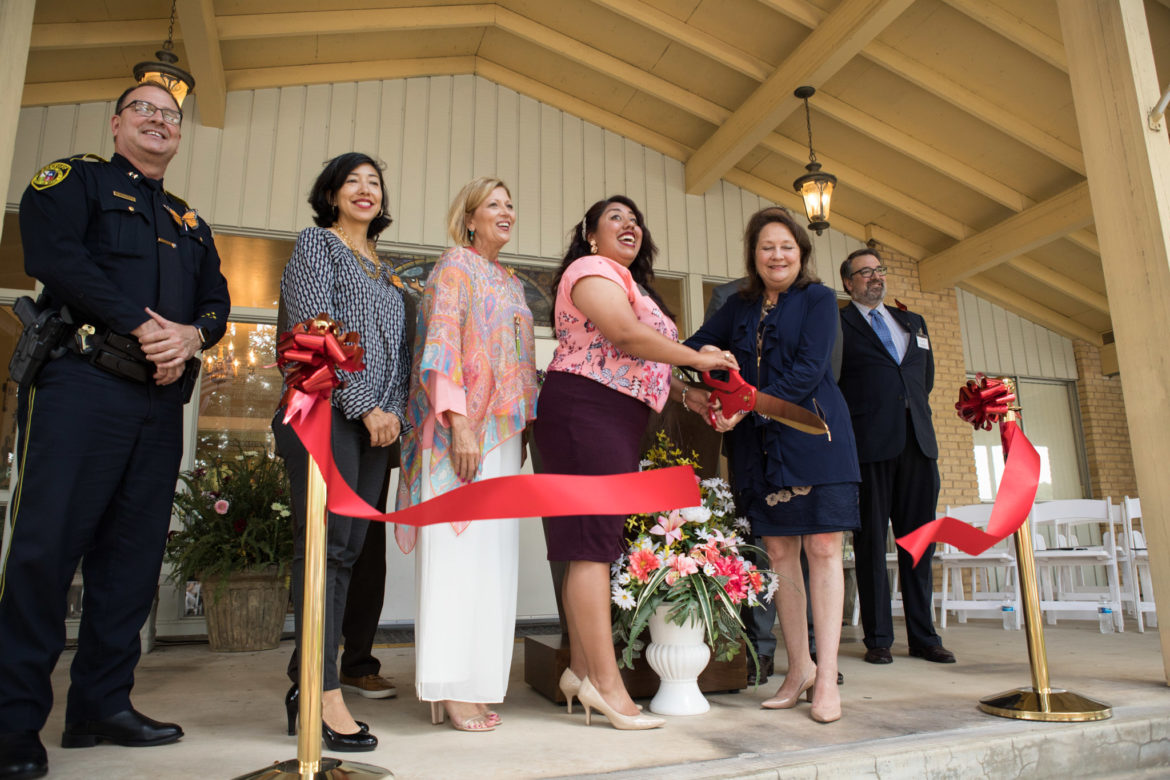A ribbon is cut in honor of the grand opening of My Mariposa Home.