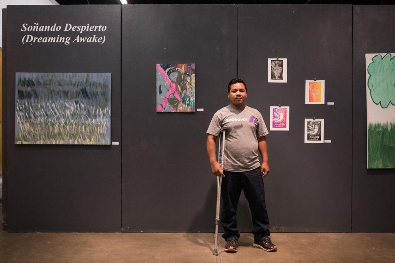 Reniery Mendoza stands between his five piece in the show.