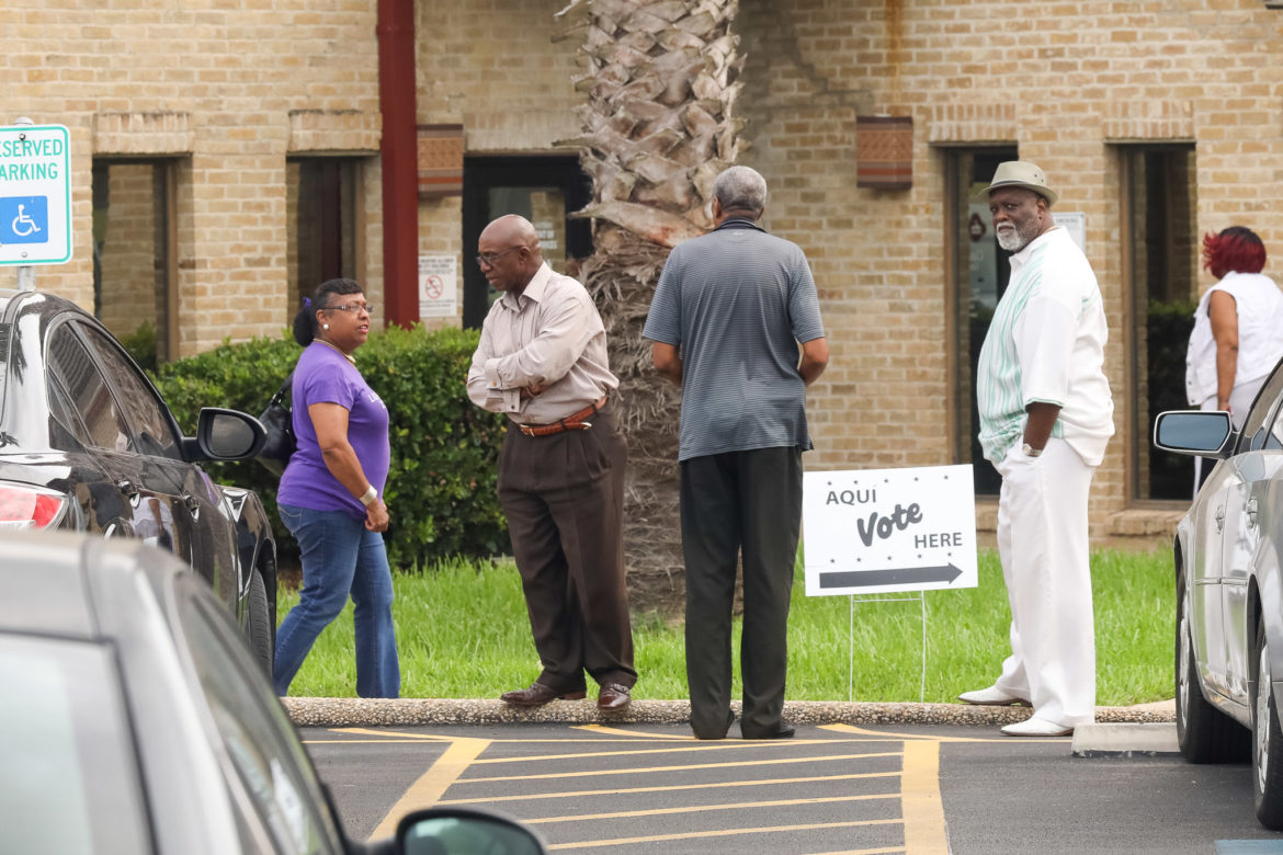 District 2 candidate Keith Toney in front of the Claude Black Community Center during the first day of early voting.