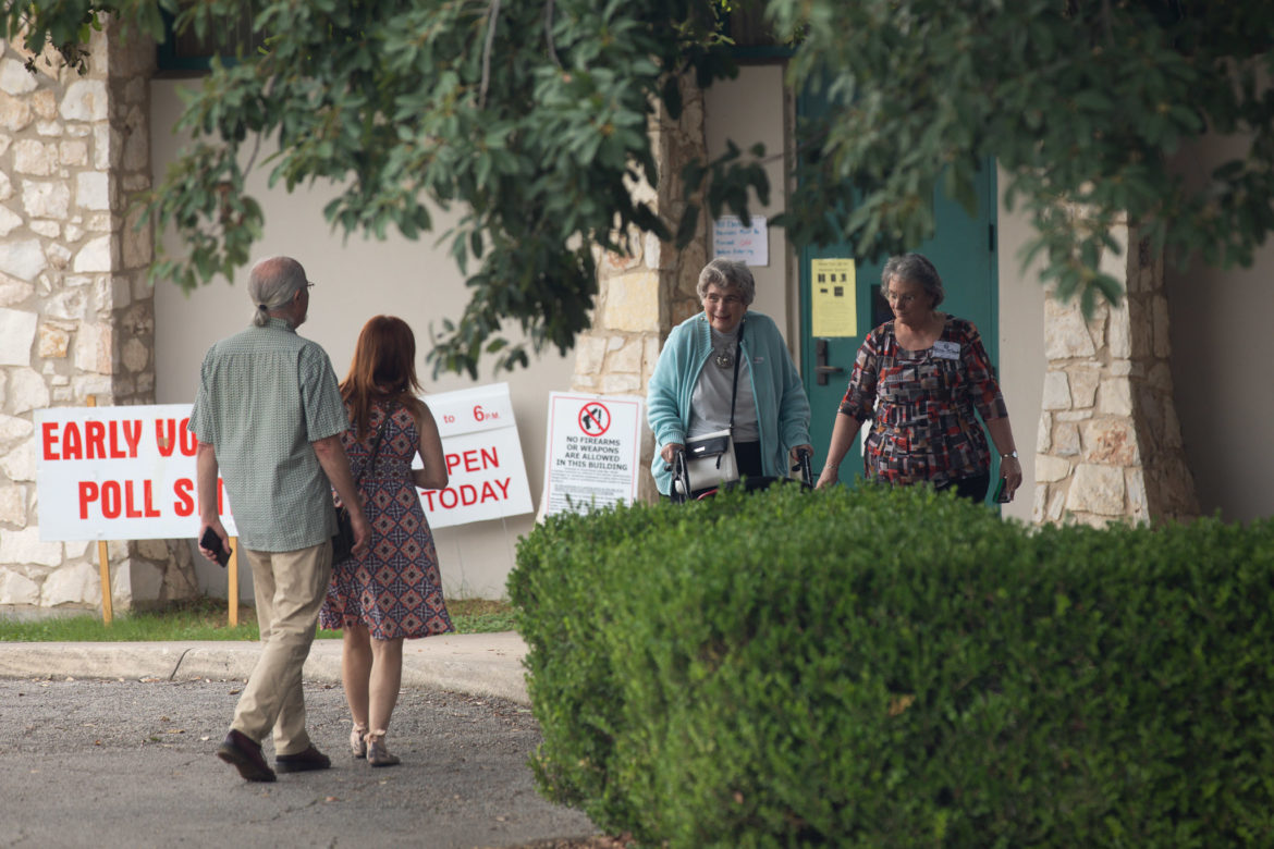 Lila Cockrell exits the early voting site at Lion's Field Adult and Senior Center after voting successfully.
