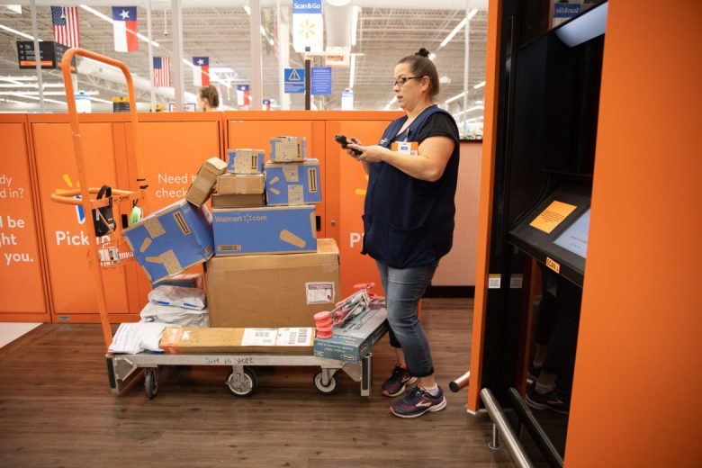 Wal-Mart employees load the pickup machine the same way customers remove their items.