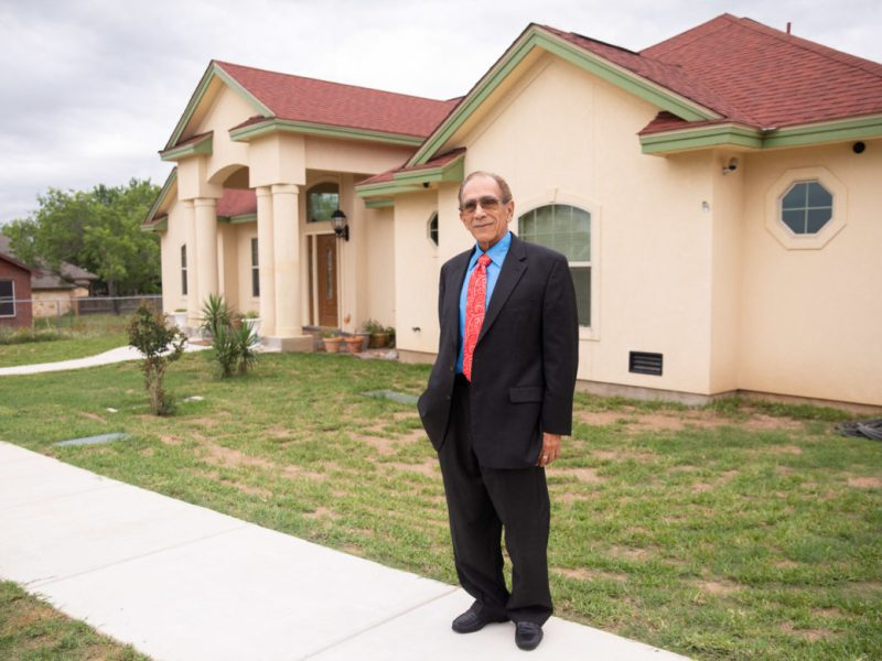 Roy Idrach in front of his Floresville home.
