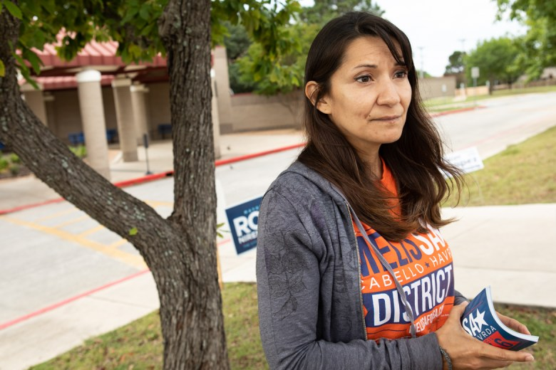 Melissa Cabello Havrda greets voters outside of Christian Evers Elementary School.