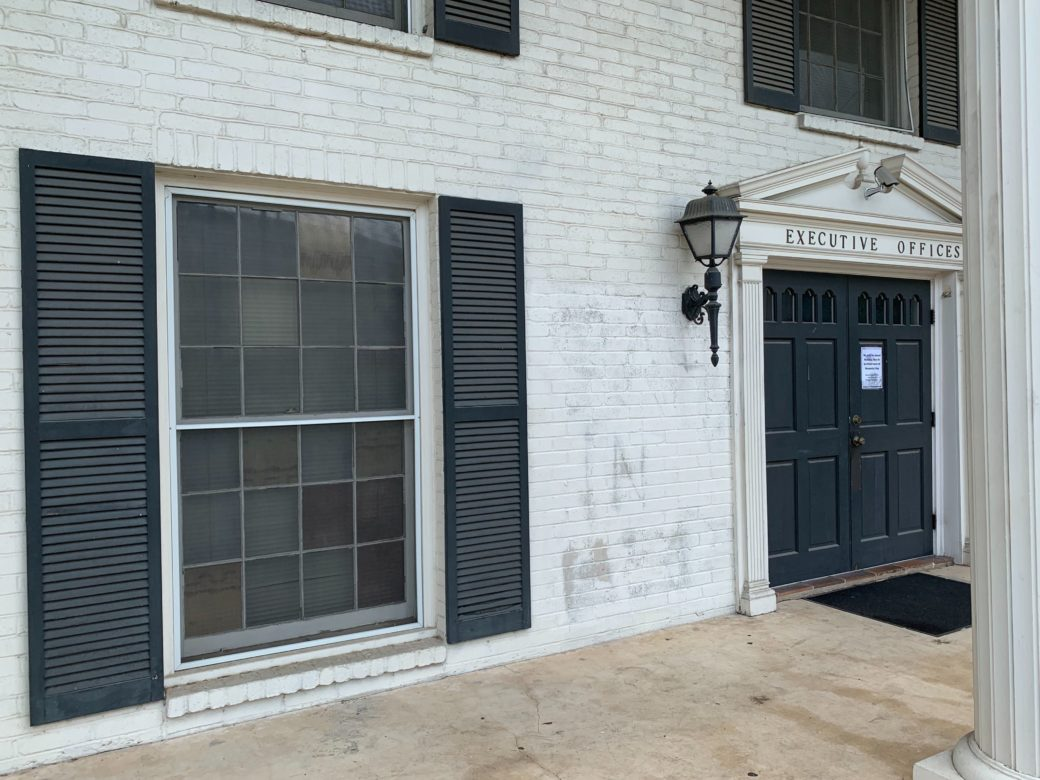 The spray paint on the San Antonio Firefighters Association's union hall had been mostly scrubbed off by the afternoon.