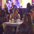 Supporters of Presidential candidate Julián Castro clap at his response to a question during a watch party at Cadillac Bar.