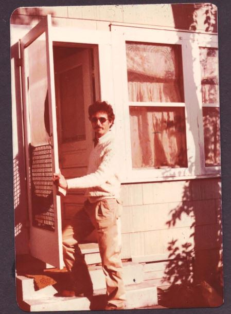 Don Mathis stand at the back door of his home sometime in the 80's.