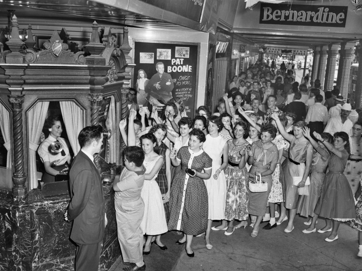 Eager attendees arrive to the showing of a performance by American singer Pat Boone at the Majestic Theatre.